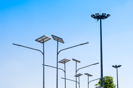 LED street light with solar cell, electric spot light in blue sky background. Green energy concept.