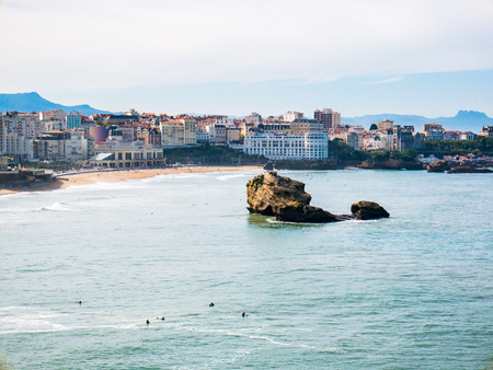 Rock formations and swimmers can be seen at the seaside town of Biarritz in Basque Country.