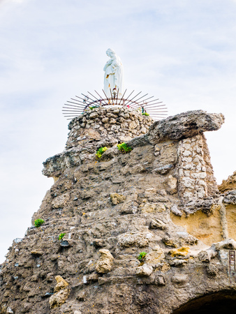 rock formation: The statue of the Virgin Mary sits atop the rock formation at Rocher de la Vierge, Biarrtiz, Basque Country
