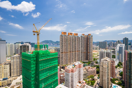 High rise buildings can be seen all over Kowloon taken from the top of a building