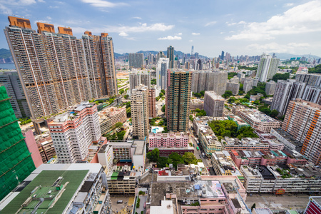 High rise buildings can be seen all over Kowloon taken from the top of a building Stock Photo