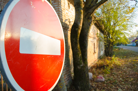 Stop sign by the side of the road. Stock Photo