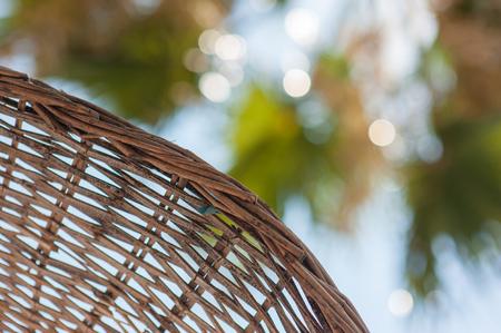 brown beach umbrella saves from the scorching sun. Banco de Imagens