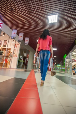 girl goes shopping in search of discounts. Stock Photo