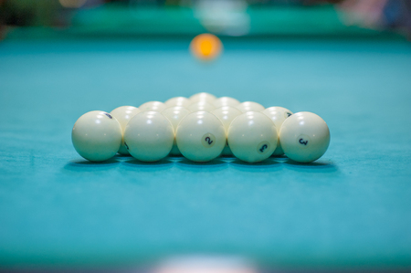 placement of balls on a billiard table, preparation for a strike. Billiards club. Stock Photo