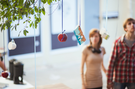 Red frame weighs, hung red apple. Street art