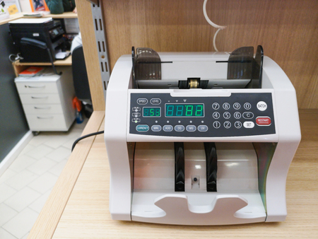 the counting machine counts many bills for one hundred American dollars of a new sample. The counting of the money. The concept of Finance. Machine for money