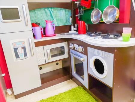 Children's kitchen, kindergarten and toys for children. Small kitchen. Miniature cooking area