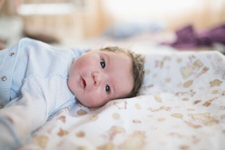 first day of the child at home. Newborn baby sleep first days of life. Cute little newborn child sleeping peacefully.