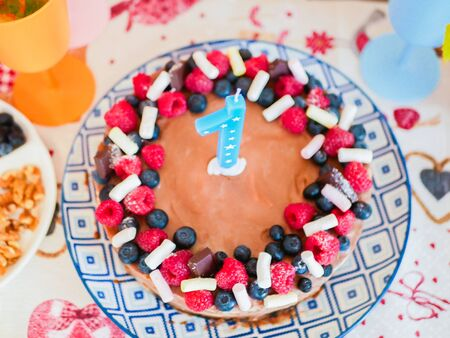Happy Birthday.Holiday cake with candles.Birthday greetings.Greeting card.celebrate birthday party with gorgeous candy bar. first birthday cake with number 1 ,one on top. first year concept