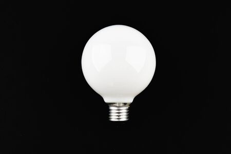 round light bulb on a black background. place for an inscription. view from above Stock fotó