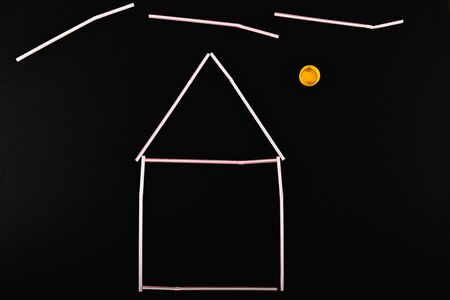 plastic house. Plastic model of the house. On a black background. Real estate concept Stok Fotoğraf