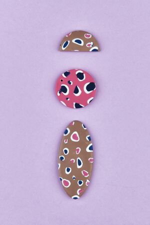 polymer clay product. handmade earrings. do it yourself. Colorful ethnic pendant charm of polymer clay. Handmade jewelry of polymer clay