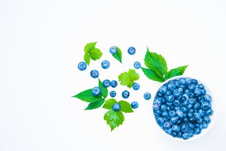 Fresh blueberries on a white background. Healthy summer fruit. Taste of summer. Growing of blueberries. Advertising on blueberries. Fresh blueberries on a white