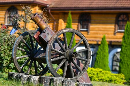 old iron gun. A cannon that shoots cores. Burning wick. Current model of an old artillery gun. naked gun, cannon on wheels, american civil war.