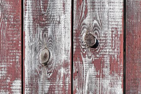 red-gray wooden background. vertical boards. old paint peels off. old boards. Red gray wood texture of a worn painted board. Red gray wood texture of old worn painted board.