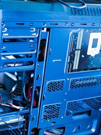 system computer unit. black computer case with blue light.