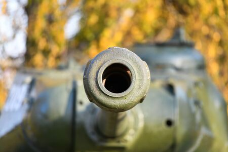 Barrel with a tank close-up. A close up shot of a rusty military tank gun, tank canon. The barrel of the Soviet anti-tank rifle. Artillery gun close-up. Shallow depth of field.