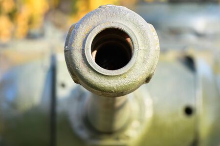 Barrel with a tank close-up. A close up shot of a rusty military tank gun, tank canon. The barrel of the Soviet anti-tank rifle. Artillery gun close-up. Shallow depth of field