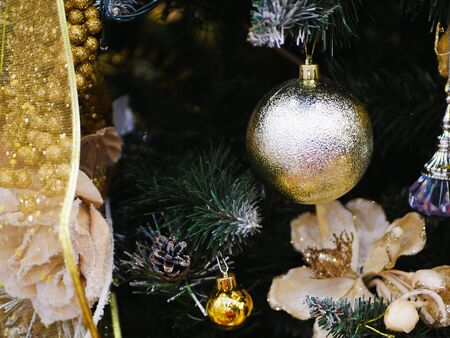 Christmas tree decoration close-up. Christmas and New Year decorate the interior with gifts and a Christmas tree. Xmas holyday concept, colorful traditional ornaments.