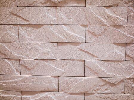 unebene Steinfassade Nahaufnahme. Zerrissene Steinstruktur. Steinwand. Stonewall-abstrakter Hintergrund.