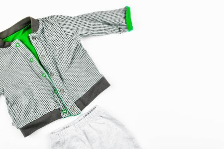 Baby clothes on a white background. flat lay. checkered jacket. place for writing. Childrens fashion Foto de archivo - 134876333