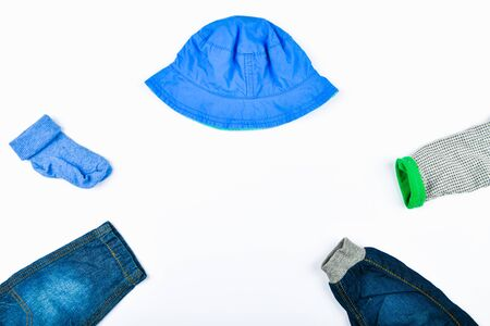 Blue baby clothes. flat lay. Jeans socks and panama. place for writing. Foto de archivo - 134876338