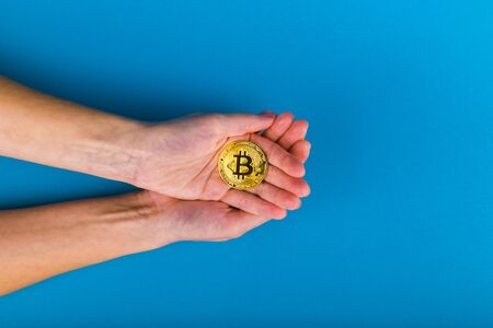 save bitcoins. Bitcoin Care Concept. Place for an inscription. Bitcoin and hand. contribution to the future.