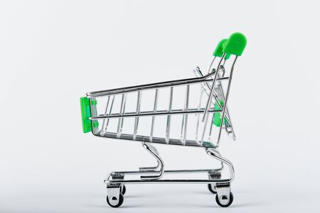 Shopping trolley on a white background. Green color. Place for an inscription. Shopping concept