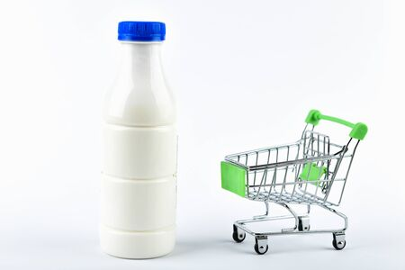 Buying milk trading concept. Shop online. Basket and milk on a white background. healthy eating concept business concept.