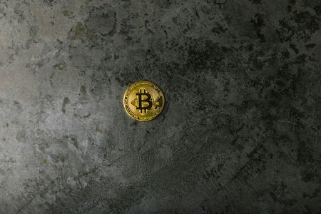 bitcoin on dark marble. place for an inscription. gold coin bitcoin against the background of a dark stone.