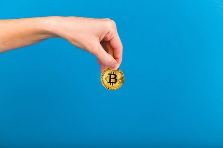 Bitcoin in the hand. Bitcoin retention concept. Place for an inscription. Bitcoin and hand. contribution to the future.