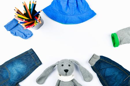 Blue baby clothes. flat lay. Jeans socks and panama. place for writing.