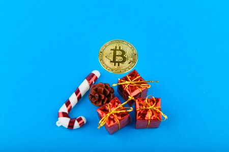 Festive concept of bitcoins. The concept of festive bitcoins. Place for an inscription. Bitcoin and Christmas. contribution to the future. Place for inscription.