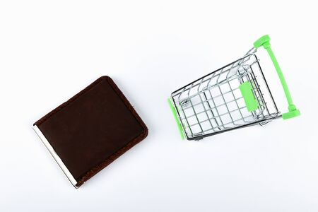 Shopping concept. Online shopping concept. Cart and red wallet over a white background. lack of time, waste of time, buying time, shopping concept, business concept
