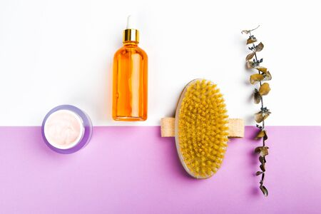 Skin care products. Anti-cellulite massage brushes. view from above. Massage brush. On a pink background. Accessories for massage. Flatley. eco care concept. Skin care products on white