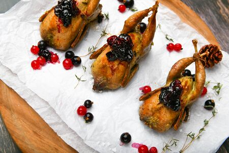 Quail fried. On a wooden background. Little turkey. Close-up