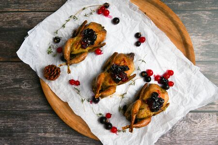 quail on a wooden background. On a wooden background. Little turkey. Close-up. Three quails. Small bird. Chicken replacement