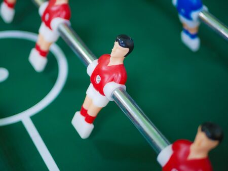 Table soccer. A game of table football. Entertainment for the company.