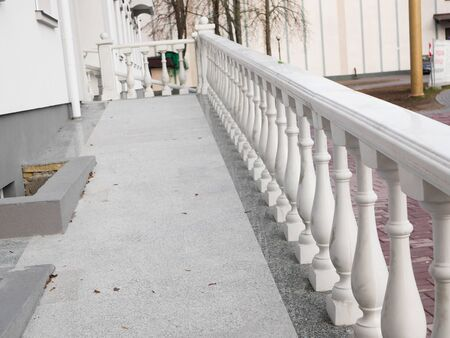 white railing. Beautiful vintage white concrete balcony railing