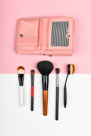 Makeup brushes. and wallet. flat lay. visage and money concept. Professional Makeup Brushes.
