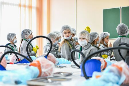 A group of children in medical coats. Interest in medicine in children. Children in medical gowns. Medical training. KHARKOV, UKRAINE - JANUARY 20, 2020.