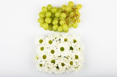 Natural grape concept. The concept of the usefulness of grapes. on a white background top view. A place to write. A bunch of green grapes