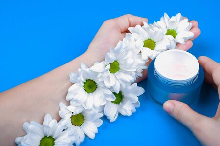 Hand cream. Natural creams for healthy skin. Natural cosmetic. The concept of natural medicine. flat lay. Blue background Archivio Fotografico - 140116192