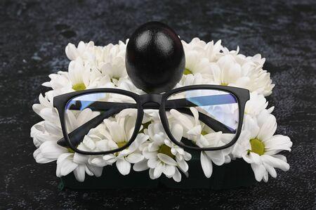 Black glasses and eggs. Black easter concept. Black eggs. Easter for black people Archivio Fotografico - 140117754