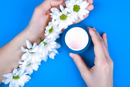 Hand cream. Natural creams for healthy skin. Natural cosmetic. The concept of natural medicine. flat lay. Blue background Archivio Fotografico - 140115814