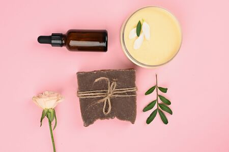 natural body care. Cream care in a jar with a beautiful rose. anti-aging cream. Cream for skin care. for hands. for face. cosmetics for care