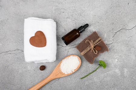 Flat lay of love for spa. Flat layout with accessories, spa cosmetics, bath salt, cream and towels. Skin Care, Natural Cosmetics. 版權商用圖片