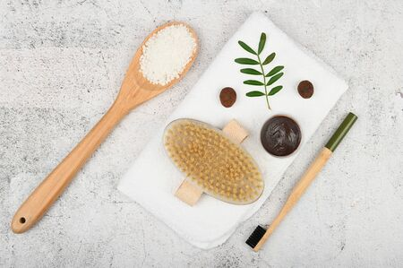 Flat lay on eco cosmetics. Flat layout with accessories, spa cosmetics, bath salt, cream and towels. Skin care product, natural cosmetics, flat styling. 版權商用圖片