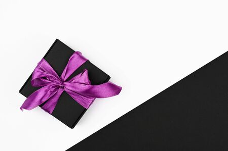 Gift wrapping by bow on a black and white background. Stock Photo